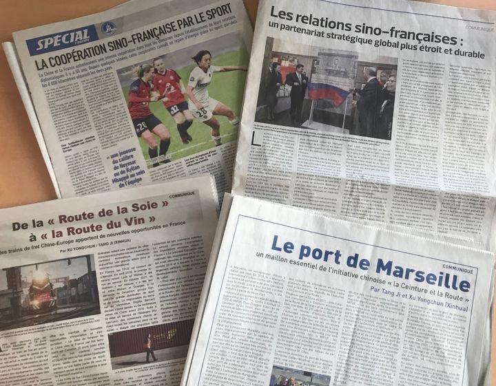 Pages de communiqués signés par l'agence d'Etat chinoise Xinhua, dans quatre quotidiens français, le 25 mars 2019. (CAMILLE CALDINI / FRANCEINFO)