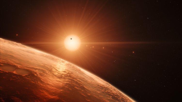 Vue d'artiste présentant ce qui pourrait se trouver à la surface de la planète Trappist-1f, où la présence d'eau liquide est possible.  (M. KORNMESSER / EUROPEAN SOUTHERN OBSERVATORY / NASA /JPL-CALTECH)
