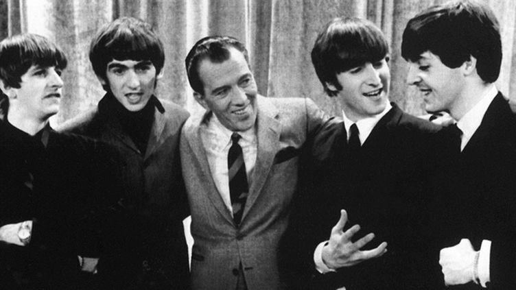 Les Beatles avec Ed Sullivan le 9 février 1964  (UPI / AFP)