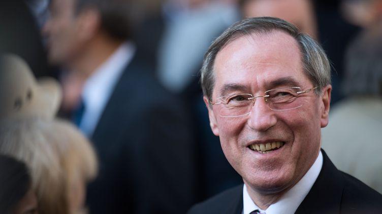 L'ancien ministre de l'Intérieur Claude Guéant quitte le siège de l'UMP, le 8 juillet 2013 à Paris. (MARTIN BUREAU / AFP)