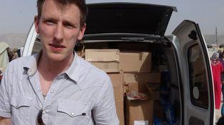 L'Américain Peter Kassigparticipait à une opération de distribution de vivres à la frontière syrienne, entre fin 2012 et début 2013. (KASSIG FAMILY / AFP)