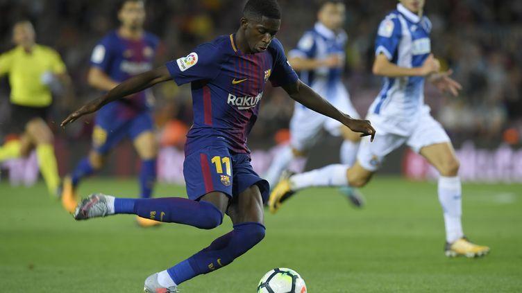 Ousmane Dembélé auteur d'une passe décisive contre l'Espanyol Barcelone. (LLUIS GENE / AFP)