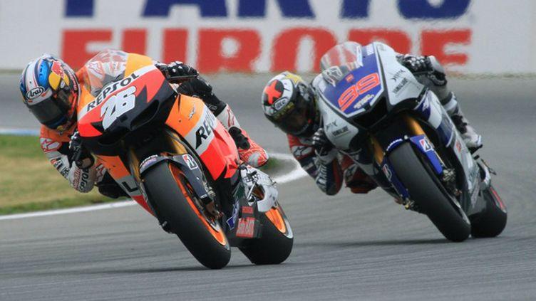Jorge Lorenzo et Dani Pedrosa sont au coude à coude dans ce Championnat du monde MotoGP  (RADEK MICA / AFP)