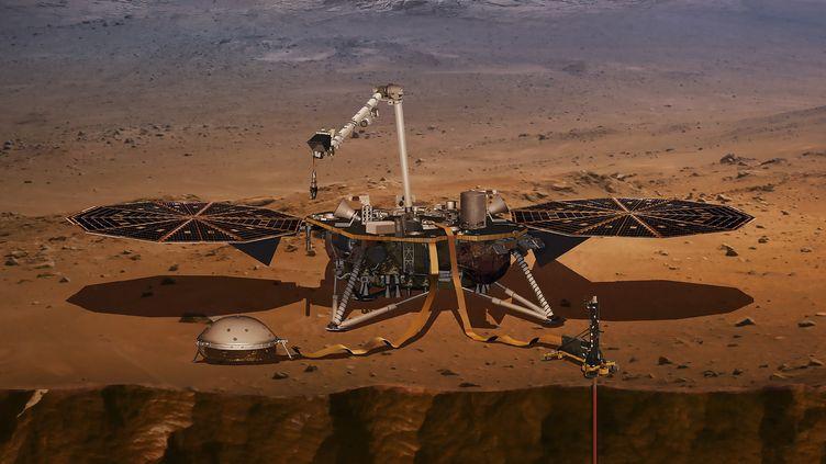 Illsutration du robotInSight par la NASA et du sismomètre Seis, 2018. (NASA / NASA)
