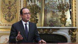 Le président de la République, François Hollande, le 31 décembre 2014 à l'Elysée. (IAN LANGSDON / AFP)