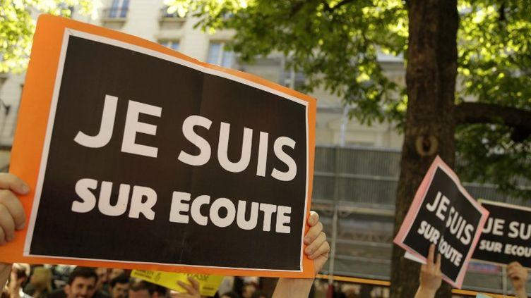 Manifestation contre la loi sur le renseignement à Paris, le 13 avril 2015. (CITIZENSIDE.COM / AFP)