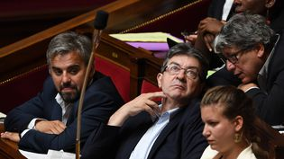 De gauche à droite, les députés de La France insoumise Alexis Corbière, Jean-Luc Mélenchon, Mathilde Panot et Eric Coquerel, à l'Assemblée, le 12 juillet 2017. (ALAIN JOCARD / AFP)