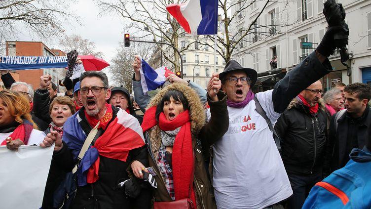"""Lors de la manifestation des """"foulards rouges"""", le 27 janvier 2019 dans les rues de Paris. (MAXPPP)"""
