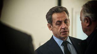 Le président de l'UMP, Nicolas Sarkozy, au siège du parti, à Paris, le 1er décembre 2014. (ROMAIN CARRE / NURPHOTO / AFP)