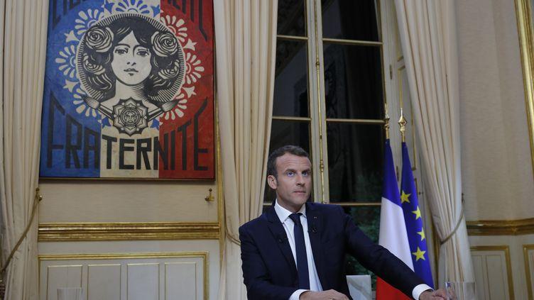Le président de la République Emmanuel Macron, à l'Elysée, avant son entretiensur TF1, le 15 octobre 2017. (PHILIPPE WOJAZER / POOL/ AFP)