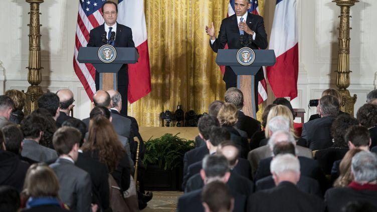 Lors de la conférence de presse commune de Barack Obamaet François Hollande, à Washington, le 11 février 2014. (BRENDAN SMIALOWSKI / AFP)