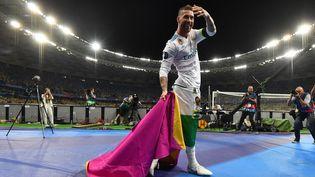 Sergio Ramos, après avoir gagné la Ligue des champions, le 26 mai 2018. (GENYA SAVILOV / AFP)