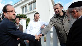 François Hollande après sa visite à l'école Ozar Hatorah de Toulouse, lundi 19 mars 2012. (REMY GABALDA / AFP)