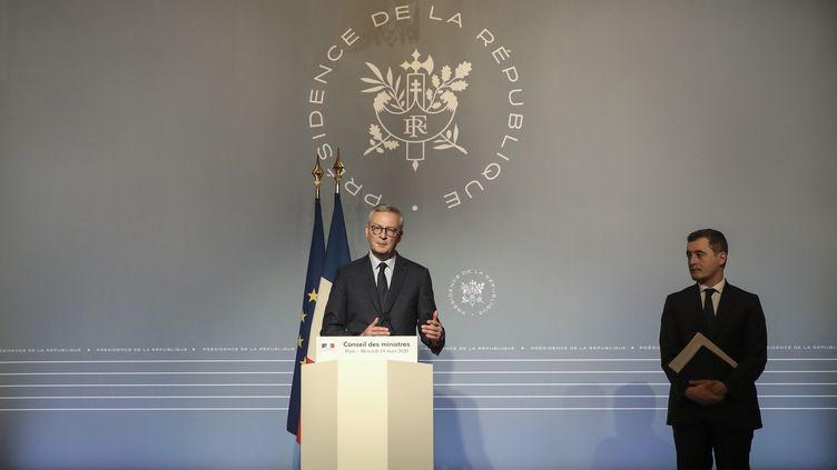 Le ministre de l'Economie, Bruno Le Maire, et le ministre des Comptes publics, Gérald Darmanin, lors d'une conférence de presse, à Paris, le 18 mars 2020. (AFP)