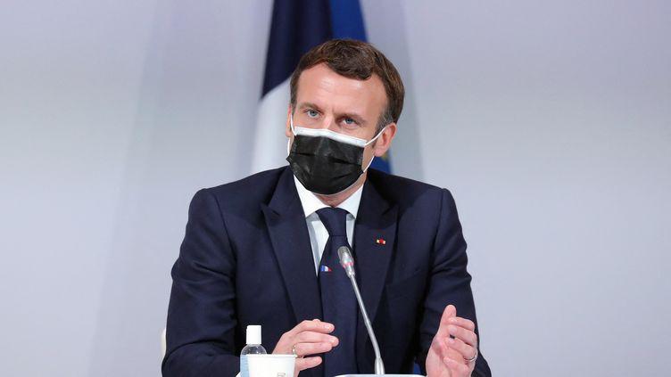 Emmanuel Macron devant la Convention citoyenne pour le climat, le 14 décembre 2020, à Paris. (THIBAULT CAMUS / AFP)