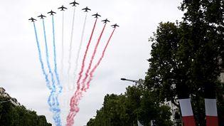 La Patrouille de France au dessus des Champs-Elysées à paris, le 14 juillet 2019. (PHILIPPE LOPEZ / AFP)
