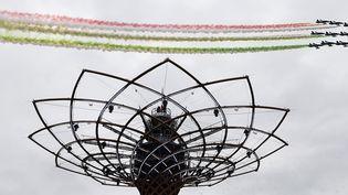 Une patrouille de l'armée de l'air italienne survole la cérémonie dinauguration de l'Exposition universelle de Milan, le 1er mai 2015  (Olivier Morin / AFP)