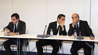 François Fillon, Nicolas Sarkozy et Alain Juppé au QG de l'UMP à Paris. (DOMINIQUE FAGET / POOL)