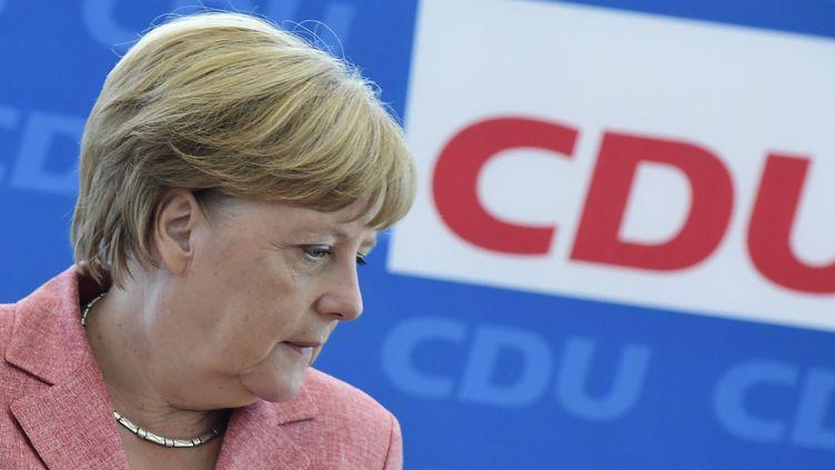 Angela Merkel lors d'un rassemblement de la CDU, le 15 août 2016, à Berlin. (TOBIAS SCHWARZ / AFP)