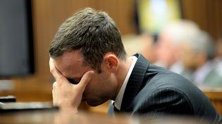 Le champion paralympique sud-africainOscar Pistorius, au tribunal de Pretoria (Afrique du Sud),le 10 mars 2014. (BONGIWE MCHUNU / AFP)
