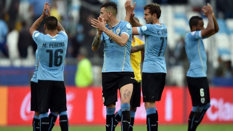 La joie des joueurs uruguayens (YURI CORTEZ / AFP)