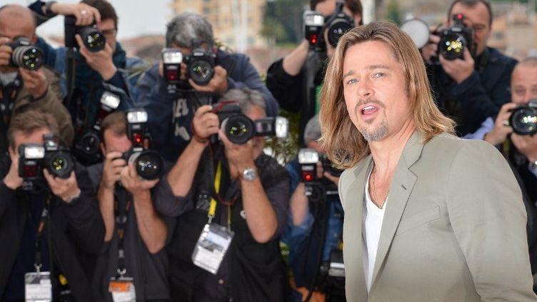 "Brad Pitt présente le film ""Killing Them Softly""à Cannes, le 22 mai 2012. (ALBERTO PIZZOLI / AFP)"