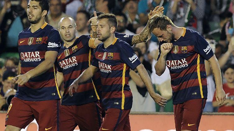 La joie des joueurs du FC Barcelone (CRISTINA QUICLER / AFP)