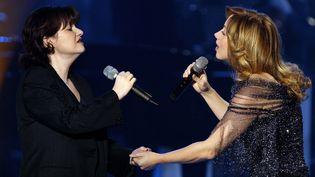 Maurane et Lara Fabian chantent au Zénith de Paris, le 15 février 2003. (FRANCOIS GUILLOT / AFP)