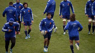 L'équipe de France de rugby s'entraîne à Marcoussis (Essonne) avant son match contre l'Angleterre, le 30 janvier 2014. (MARTIN BUREAU / AFP)