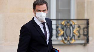 Olivier Véran quitte l'Elysée (Paris), le 20 janvier 2021. (LUDOVIC MARIN / AFP)