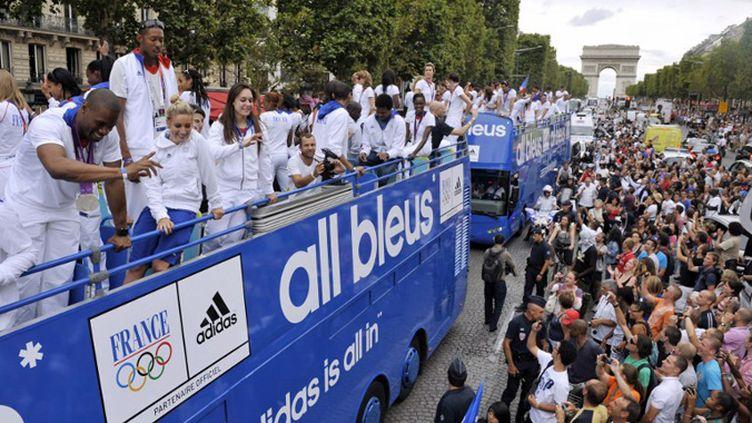 Retour triomphal des Bleus après les JO de Londres (MEHDI FEDOUACH / AFP)