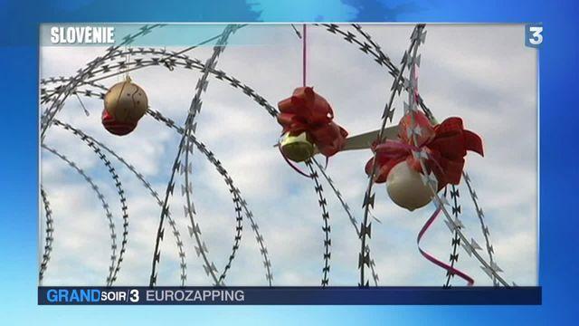 Eurozapping : des boules de Noël sur les barbelés