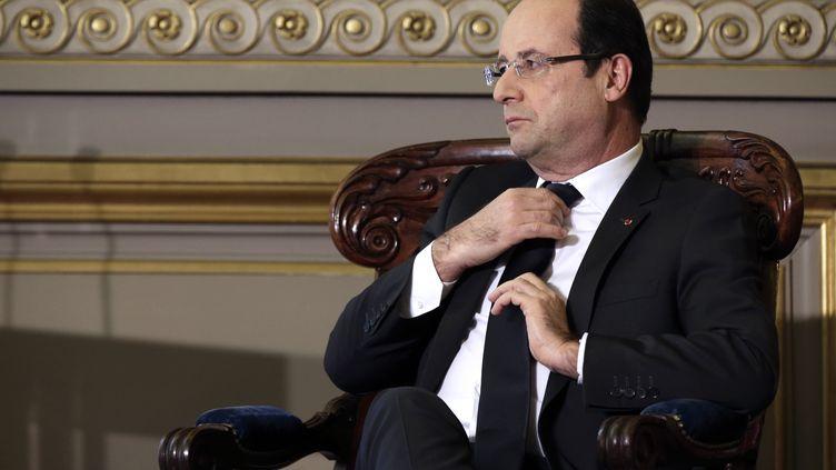 François Hollande, le 18 janvier 2013,lors de l'audience solennelle de rentrée de la Cour de cassation àParis. (PHILIPPE WOJAZER / AFP)