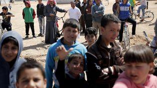 Des réfugiés syriens dans le camp de Zaatari, à la frontière jordanienne, en mars 2017. (THOMAS COEX / AFP)