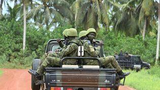 Des soldats ivoiriens, le 10 juin 2021 près de l'Académie internationale de lutte contre le terrorisme, à Jacqueville (Côte d'Ivoire). (ISSOUF SANOGO / AFP)