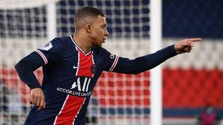 L'attaquant français du PSG après un but marquélors du match de L1 entre le club parisien et Montpellier, au stade du Parc des Princes, à Paris, le 22 janvier 2021. (FRANCK FIFE / AFP)