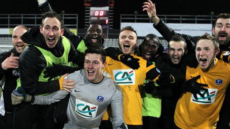 La joie des joueurs de Quevilly (CHARLY TRIBALLEAU / AFP)