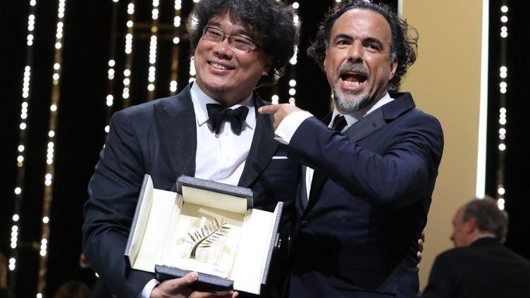 Le réalisateur coréen Bong Joon-Ho et le président du Jury Alejandro Gonzalez Iñarritu (VALERY HACHE / AFP)