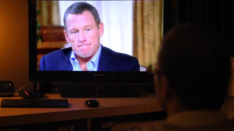 Lance Armstrong, le 17 janvier 2013 lors d'un interview avec Oprah Winfrey. (MANDEL NGAN / AFP)