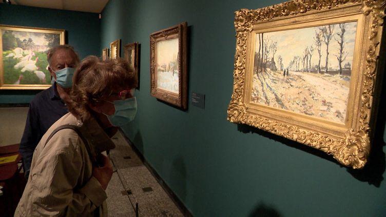 Parmi les 9 tableaux exposés au musée des Beaux-Arts de Rouen, cette toile deClaude Monet :Route, effet de neige, soleil couchant- Rouen, musée des Beaux-Arts (MNR 1002) (E. Laperdrix /  France Télévisions)