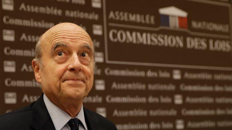 Alain Juppé devant la commission des lois de l'Assemblée nationale, à Paris, le 21 février 2019. (THOMAS SAMSON / AFP)