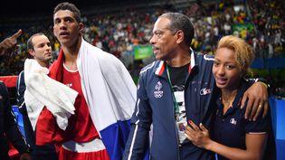 Tony Yoka,Luis Mariano Gonzalez et Estelle Mossely, lors de la finale des supers-lourds aux Jeux de Rio, le 20 août 2016. (YURI CORTEZ / AFP)