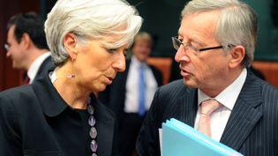 La directrice générale du FMI Christine Lagarde et le président de l'Eurogroupe Jean-Claude Juncker à Bruxelles (Belgique), le 14 juin 2011. (GEORGES GOBET / AFP)
