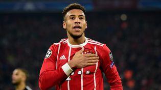 Le Français Corentin Tolisso, joueur du Bayern Munich, célèbre un but contre le PSG, lors d'un match de Ligue des champions, à Munich (Allemagne), le 5 décembre 2017. (TOBIAS SCHWARZ / AFP)