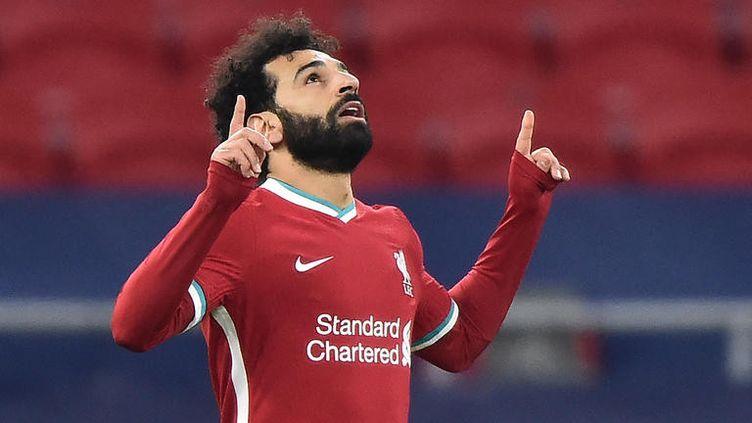 Le joueur de Liverpool, Mohamed Salah, célèbre son but face à Leipzig, le 10 mars 2021, en 8e de finale retour de la Ligue des champions. (ATTILA KISBENEDEK / AFP)