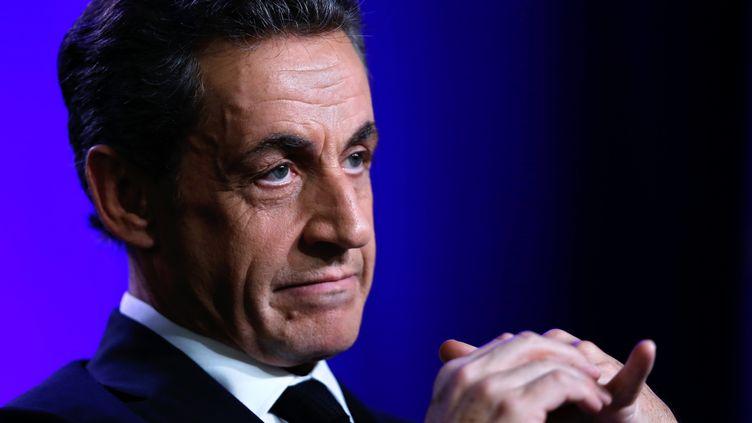 Le président de l'UMP Nicolas Sarkozy lors d'un déplacement de campagne pour les élections départementales à Asnières-sur-Seine (Hauts-de-Seine), le 24 mars 2015. (THOMAS SAMSON / AFP)