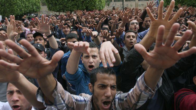 Des étudiants partisans du président déchu Mohamed Morsi, le 19 mars 2014 au Caire (Egypte). (MOHAMED EL-SHAHED / AFP)