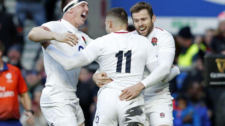 Les Anglais fêtent leur premier essai face à la France, le 10 février 2019. (ADRIAN DENNIS / AFP)