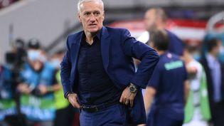 Didier Deschamps, hagard, après l'élimination de l'équipe de France en huitièmes de finale de l'Euro 2021, contre la Suisse. (FRANCK FIFE / AFP)