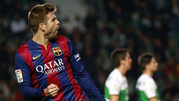 La joie de Gerard Piqué (Barcelone) (JOSE JORDAN / AFP)